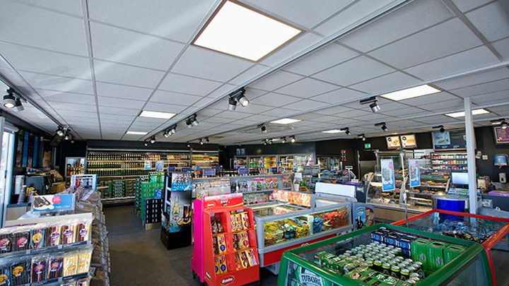 Philips gas station lighting products cover the ceiling of Q8 Qvik to go store