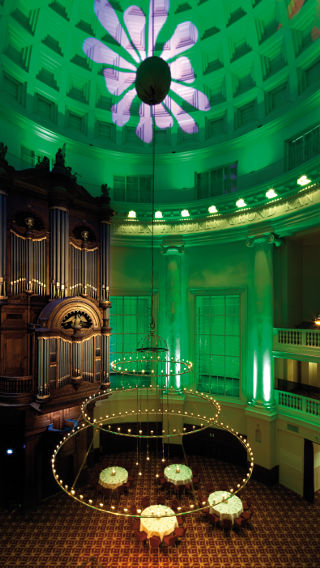 A green light emits from the Philips decorative lighting products in this room at the Renaissance Hotel