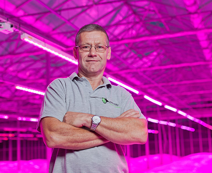 Maarten Bloemen posing at his nursery lit up with Greenpower LED lights by Philips Lighting