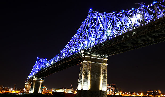 Jacques Cartier Bridge illumination reflects the vibrant energy of Montreal with architectural lighting