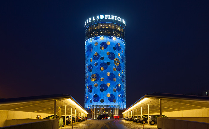 The front side of the Fletcher hotel impressively illuminated by Philips and Livingprojects