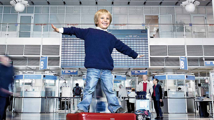 Kid playing in a well illuminated airport terminal